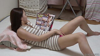Nonoka Saki masturbates while reading a porn magazine