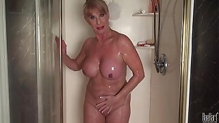 Grown up woman in the shower